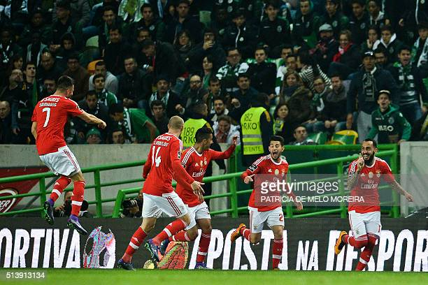 Benfica's Greek forward Kostas Mitroglou celebrates with teammates after scoring a goal during the Portuguese league football match Sporting CP vs SL...
