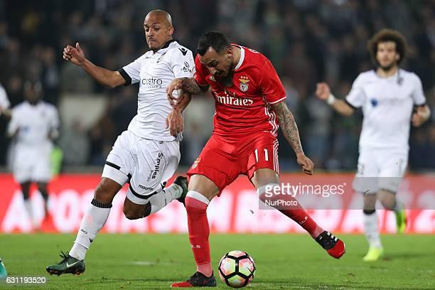 Benfica's Greek forward Kostas Mitroglou score a goal with Vitoria SC's Portuguese defender Bruno Gaspar during the Premier League 2016/17 match...