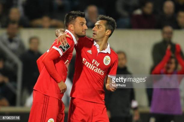 Benfica's Greek midfielder Andreas Samaris celebrates after scoring goal with teammate Benfica's Brazilian forward Jonas during the Premier League...