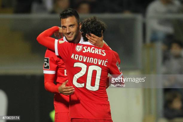 Benfica's Greek midfielder Andreas Samaris celebrates after scoring goal with teammate Benfica's Croatian midfielder Filip Krovinovic during the...