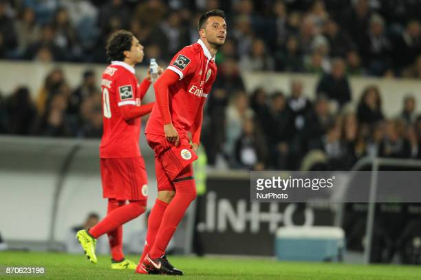 Benfica's Greek midfielder Andreas Samaris celebrates after scoring goal during the Premier League 2017/18 match between Vitoria SC and SL Benfica at...