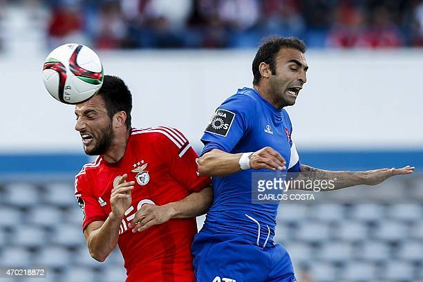 Benfica's Greek midfielder Andreas Samaris vies with Belenenses's midfielder Carlos Martins during the Portuguese league football match CF Os...