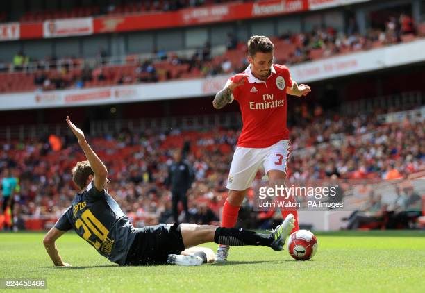 Benfica's Grimaldo is tackled by Red Bull Leipzig's Benn Schmitz during the Emirates Cup match at the Emirates Stadium London
