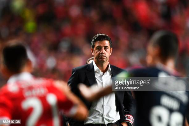 Benfica's head coach Rui Vitoria stands on the sideline during the Portuguese League football match SL Benfica vs Os Belenenses at Luz stadium on...