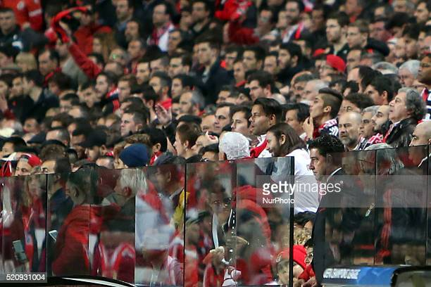Benfica's head coach Rui Vitria views the game in the middle of the fans after seen the red card during the UEFA Champions League quarterfinal second...
