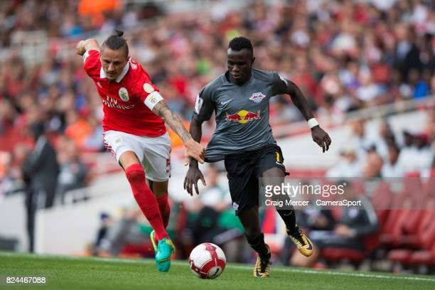 Benficas Ljubomir Fejsa battles for possession with RB Leipzig's Bruma during the Emirates Cup match between RB Leipzig and SL Benfica at Emirates...