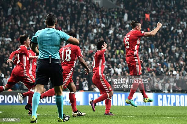 Benfica's Ljubomir Fejsa celebrates with his teammates after scoring a goal against Besiktas during the UEFA Champions League Group B football match...