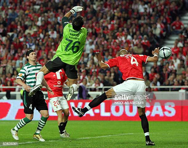 Benfica's Luisao scores the first goal of the match past Sporting goalkeeper Ricardo during their super liga football match at the Luz stadium in...