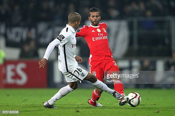 Benfica's Marooc midfielder Mehdi Carcela vies with Vitoria SC's Portuguese defender Bruno Gaspar during the Premier League 2015/16 match between...