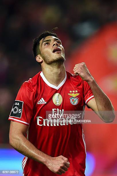 Benfica's Mexican forward Raul Jimenez celebrates after scoring during the Portuguese league football match SL Benfica vs Moreirense FC at the Luz...