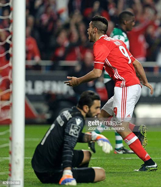 Benfica's Mexican forward Raul Jimenez celebrates his goal passing by Sporting's goalkeeper Rui Patricio during the Portuguese league football match...