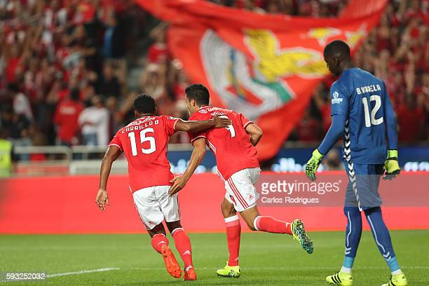 Benfica's Mexican forward Raul Jimenez celebrates scoring Benfica«s goal with Benfica's Peruvian forward Andre Carrillo during the match between SL...
