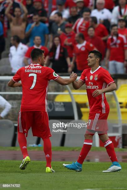 Benfica's Mexican forward Raul Jimenez celebrates with Benfica's Greek midfielder Andreas Samaris after scoring during the Portugal Cup Final...
