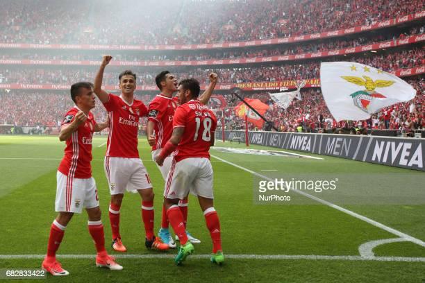 Benfica's Mexican forward Raul Jimenez celebrates with Benfica's Argentine midfielder Eduardo Salvio Benfica's Brazilian forward Jonas and Benfica's...