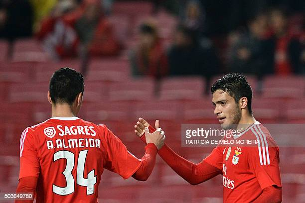 Benfica's Mexican forward Raul Jimenez celebrates with his teammate Benfica's defender Andre Almeida after scoring during the Portuguese league...