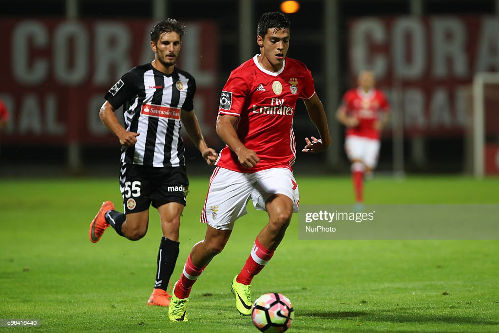 Benfica's Mexican forward Raul Jimenez in action with Nacional's Portuguese defender Mauro Cerqueira during Premier League 2016/17 match between CD...