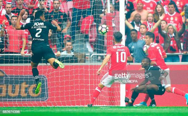 Benfica's Mexican forward Raul Jimenez scores during the Portuguese league football match SL Benfica vs Vitoria Guimaraes SC at the Luz stadium in...