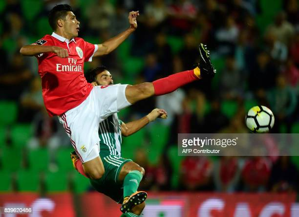 Benfica's Mexican forward Raul Jimenez vies with Rio Ave's Brazilian defender Marcelo during the Portuguese league football match Rio Ave vs SL...