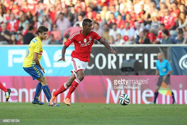 Benfica's midfielder Anderson Talisca tries to escape Estoril's midfielder Matias Cabrera in action during the Primeira Liga match between GD Estoril...