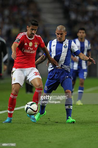 Benfica's midfielder Andre Almeida vies with Porto's defender Maxi Pereira during the match between FC Porto and SL Benfica for the Portuguese...