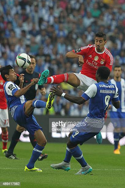PORTO PORTUGAL SEPTEMBER 20 Benfica's midfielder Andre Almeida vies with Porto's forward Corona and Porto's forward Vincent Aboubakar during the...