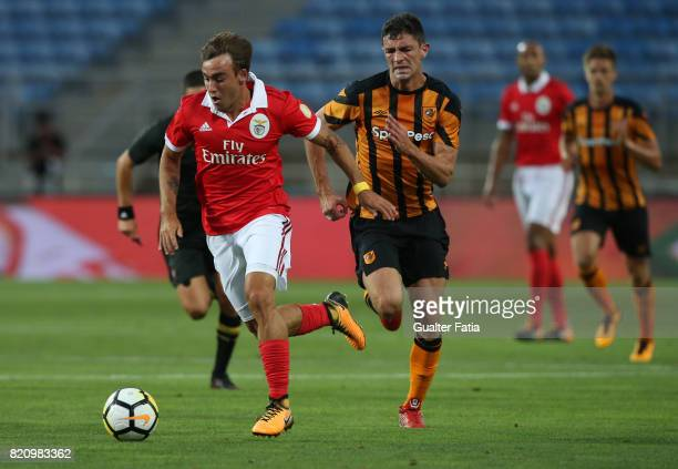 Benfica's midfielder Andre Horta from Portugal with Hull City midfielder Daniel Batty in action during the Algarve Cup match between SL Benfica and...