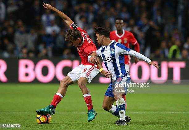 Benfica's midfielder Andre Horta with FC Porto's midfielder from Spain Oliver Torres in action during the Primeira Liga match between FC Porto and SL...