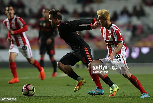 Benfica's midfielder Andre Horta with Leixoes's forward Wei Shihao from China in action during the Portuguese Cup match between SL Benfica and...