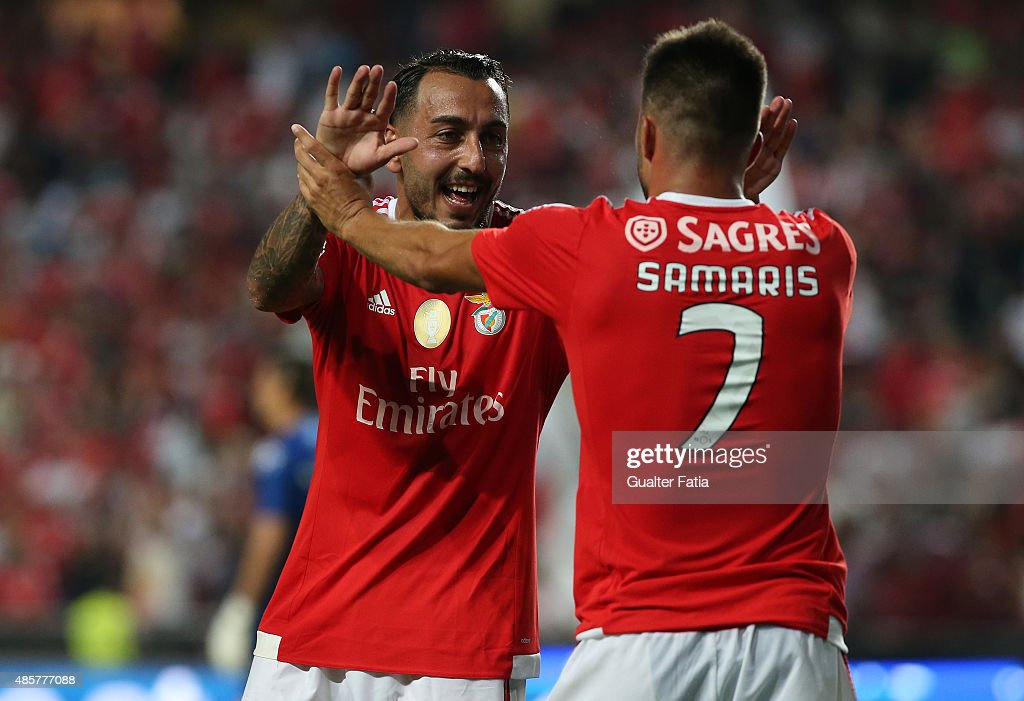 SL Benfica's midfielder Andreas Samaris celebrates with teammate Mitroglou after scoring a goal during the Primeira Liga match between SL Benfica and Moreirense FC at Estadio da Luz on August 29, 2015 in Lisbon, Portugal.