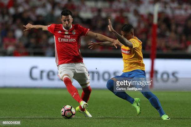 Benfica's midfielder Andreas Samaris from Greece vies with Estoril's forward Bruno Gomes from Brazil during the match between SL Benfica and Estoril...