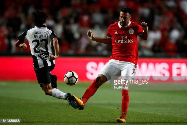 Benfica's midfielder Andreas Samaris vies for the ball with Portimonense's forward Shoya Nakajima during Primeira Liga 2017/18 match between SL...