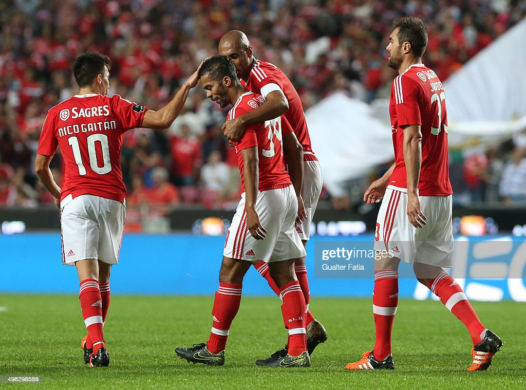 SL Benfica's midfielder Carcela celebrates with teammates after scoring a goal during the Primeira Liga match between SL Benfica and Boavista at Estadio da Luz on November 8, 2015 in Lisbon, Portugal.