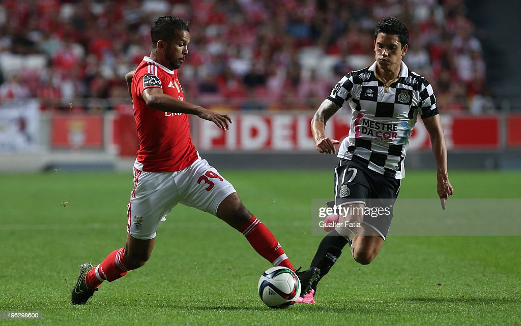 SL Benfica's midfielder Carcela with Boavista's forward Renato Santos in action during the Primeira Liga match between SL Benfica and Boavista at Estadio da Luz on November 8, 2015 in Lisbon, Portugal.