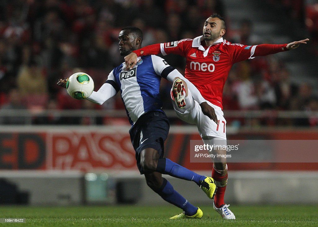 Benfica's midfielder Carlos Martins (R) vies Porto's Colombian forward Jackon Martinez (L) during the Portuguese league football match SL Benfica vs FC Porto at Luz Stadium in Lisbon on January 13, 2013.