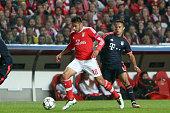 Benfica's midfielder Eduardo Salvio vies with Bayern Munich's midfielder Thiago Alcntara during the UEFA Champions League quarterfinal second leg...