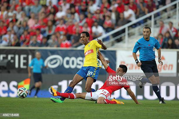 Benfica's midfielder Enzo Perez tackles Estoril's midfielder Kuca during the Primeira Liga match between GD Estoril Praia and SL Benfica at Estadio...
