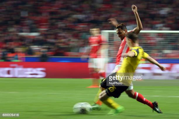 Benfica's midfielder Filipe Augusto fights for the ball with Dortmund's defender Lukasz Piszczek during the UEFA Champions League round of 16 first...