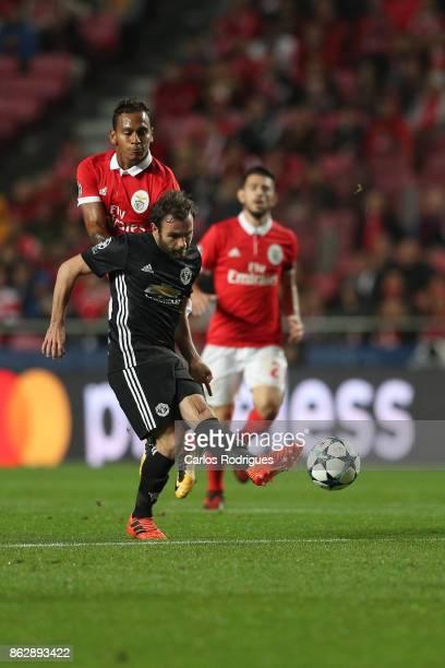 Benfica's midfielder Filipe Augusto from Brasil tackles Manchester United forward Juan Manuel Mata from Spain during SL Benfica v Manchester United...