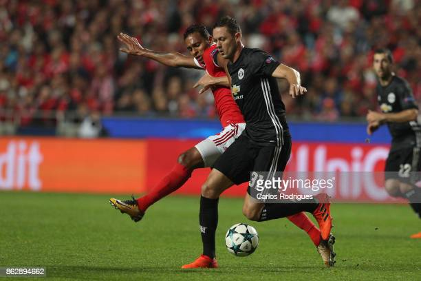 Benfica's midfielder Filipe Augusto from Brasil vies with Manchester United midfielder Nemanja Matic from Serbia for the ball possession during SL...