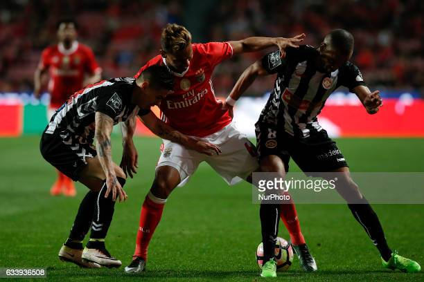 Benfica's midfielder Filipe Augusto vies for the ball with Nacional's midfielder Willyan and Nacional's forward Washington Santana during Premier...