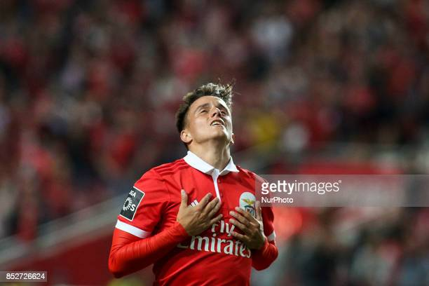 Benfica's midfielder Franco Cervi celebrates after scoring during the Portuguese League football match between SL Benfica and FC Pacos de Ferreira at...