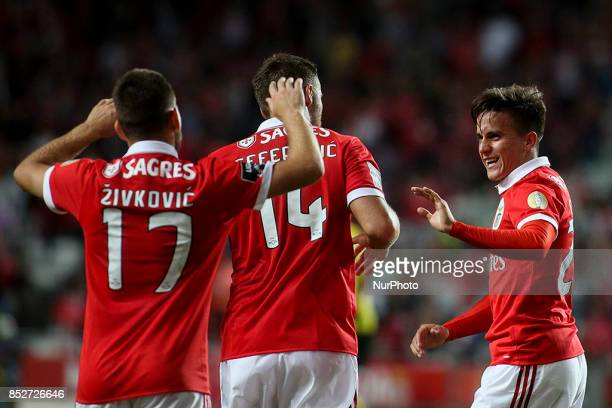 Benfica's midfielder Franco Cervi celebrates with Benfica's forward Haris Seferovic and Benfica's midfielder Andrija Zivkovic after scoring during...