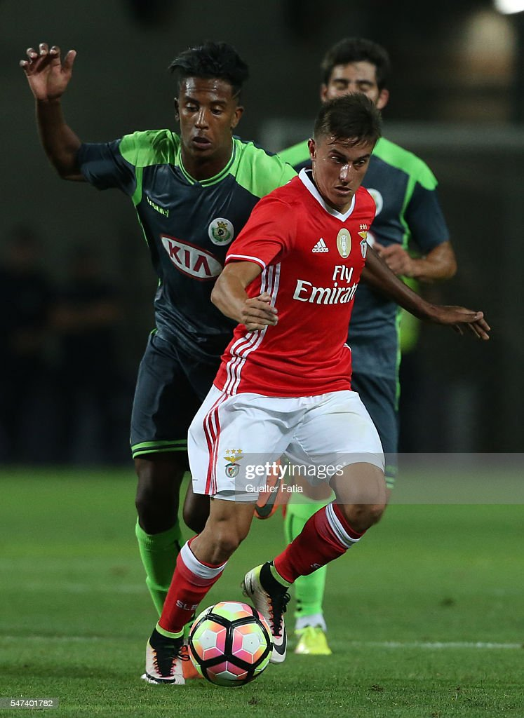 SL Benfica's midfielder from Argentina Franco Cervi with Vitoria Setubal's forward Mohcine Hassan in action during the Algarve Football Cup Pre Season Friendly match between SL Benfica and Vitoria Setubal at Estadio do Algarve on July 14, 2016 in Faro, Portugal.
