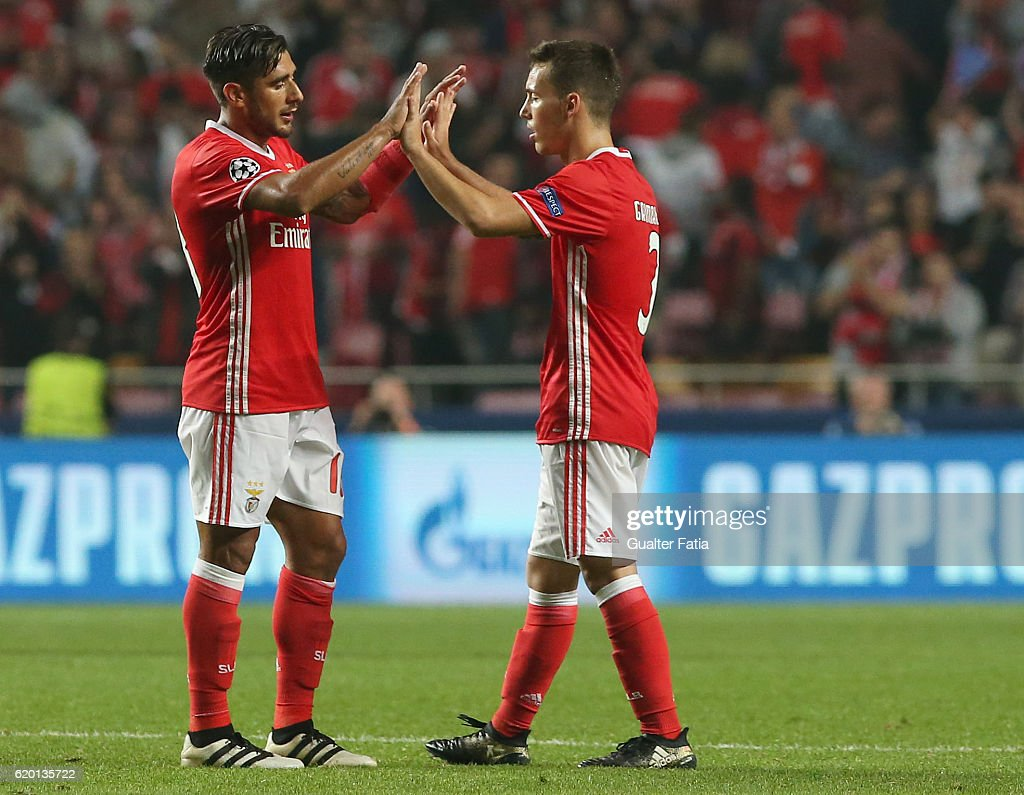 SL Benfica's midfielder from Argentina Salvio (L) celebrates with teammate SL Benfica's defender from Spain Alex Grimaldo (R) the victory at the end of the UEFA Champions League match between SL Benfica and FC Dynamo Kyiv at Estadio da Luz on November 1, 2016 in Lisbon, Portugal.