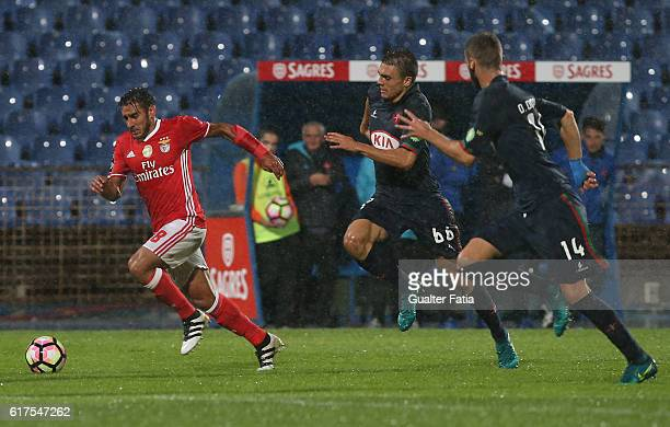 Benfica's midfielder from Argentina Salvio with Belenenses's midfielder Joao Palhinha from Portugal and Belenenses's defender Domingos Duarte from...