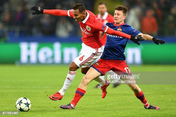 Benfica's midfielder from Brazil Filipe Augusto and CSKA Moscow's midfielder from Russia Aleksandr Golovin vie for the ball during the UEFA Champions...