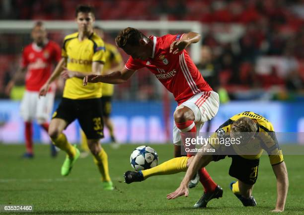 Benfica's midfielder from Brazil Filipe Augusto with Dortmund's forward Andre Schurrle from Germany in action during the UEFA Champions League Round...
