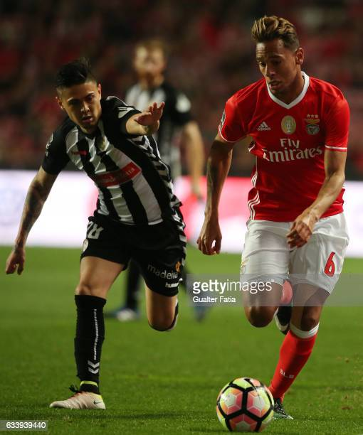 Benfica's midfielder from Brazil Filipe Augusto with Nacional's forward Willyan from Brazil in action during the Primeira Liga match between SL...