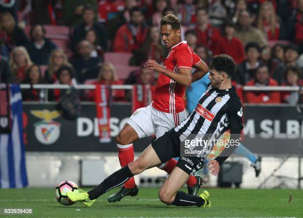 Benfica's midfielder from Brazil Filipe Augusto with Nacional's defender Tobias Figueiredo from Portugal in action during the Primeira Liga match...