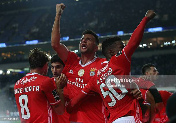 Benfica's midfielder from Greece Andreas Samaris and teammates celebrate after SL Benfica's defender from Argentina Lisandro Lopez scored a goal...
